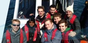 IDCore Research Engineers, wearing lifejackets on a boat, near Oban